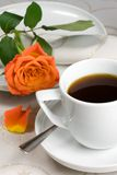 Cup with rose. Cup of coffee with orange rose Stock Photography