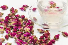 Cup of rose flower tea Stock Images