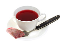 Cup of rose hip hibiscus tea with teabag Royalty Free Stock Images
