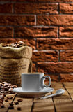 Cup and sack with coffee Royalty Free Stock Images