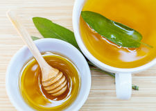 A cup of sage tea with fresh sage and honey. Stock Photo