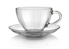 Cup and saucer. Glass cup and saucer isolated on white background Royalty Free Stock Photos