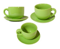 Cup with saucer. Big green cup with saucer on white background Stock Images