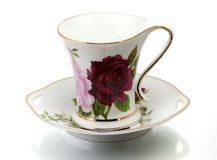 Cup and saucer. Porcelain cup and saucer royalty free stock photography