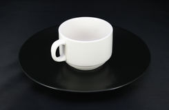 Cup and saucer on black Royalty Free Stock Images