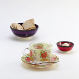Cup with saucer and bowl with cookies Stock Image