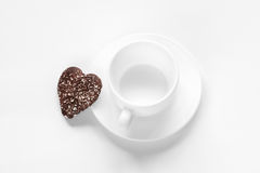 Cup and saucer and a chocolate coconut cookies Stock Image