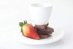 Cup with saucer, chocolate and strawberry Stock Photo
