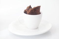 Cup with saucer and chocolate Royalty Free Stock Images