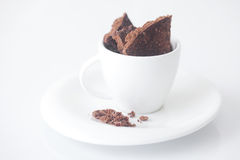 Cup with saucer and chocolate Stock Images