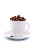 Cup and saucer with coffee beans Royalty Free Stock Image