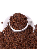 Cup and saucer with coffee beans Stock Image