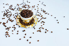 Cup and saucer with coffee beans Royalty Free Stock Photos