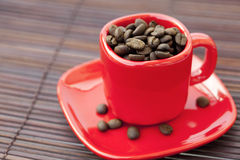 Cup,saucer and coffee beans Royalty Free Stock Photo