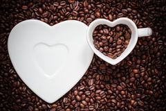Cup and saucer on coffee beans background Stock Photography