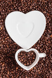 Cup and saucer on coffee beans background Stock Photo