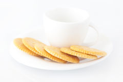 Cup with saucer and crackers Stock Photo
