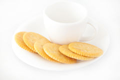 Cup with saucer and crackers Royalty Free Stock Image