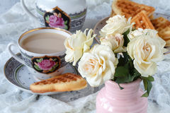 Cup with a saucer. Delicate white flowers roses. Stock Image