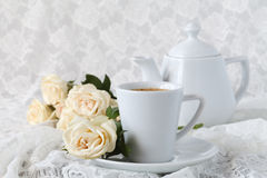 Cup with a saucer. Delicate white flowers roses. Royalty Free Stock Photos