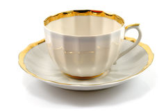 Cup and saucer with gold trim Royalty Free Stock Images
