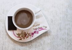 Cup and saucer, greetings happy Valentine`s day stock photo