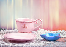 Cup and saucer over grunge background Stock Images