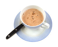 Cup and saucer of hot chocolate with spoon Stock Image