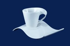 Cup and saucer, isolated,with clipping path. A modern white cup and saucer, isolated with clipping path Royalty Free Stock Photography