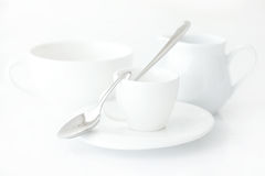 Cup with saucer, milk jug and spoon Stock Image