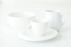 Cup with saucer and milk jug Stock Photo