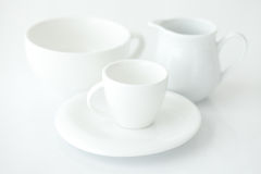 Cup with saucer and milk jug Royalty Free Stock Photography