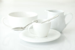 Cup with saucer and milk jug Stock Photography