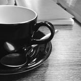 Cup and Saucer with Notebook royalty free stock photography