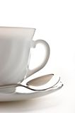 Cup with saucer and spoon. White coffee cup and saucer with spoon, isolated against a white background Stock Photo
