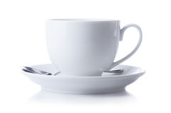 Cup at saucer with spoon on white background. Cup at saucer with spoon isolated on white background Royalty Free Stock Photography