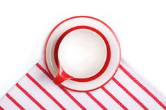 The cup and saucer on a striped napkin Stock Photo