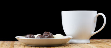 Cup and saucer sweet candy Stock Photo