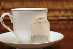 Cup saucer & tea bag Stock Image