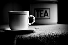 Cup of tea. Cup on the saucer with tea box in the background Royalty Free Stock Photography