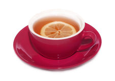 Cup and saucer of tea with lemon on top Royalty Free Stock Images