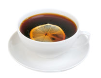 Cup on saucer with tea and slice of lemon Stock Image