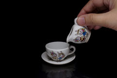 Cup and saucer. Miniature of a cup and saucer Stock Photos