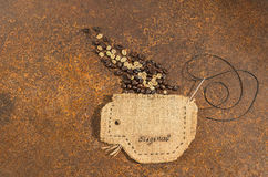 A cup sewn in jute  full of coffee beans. Royalty Free Stock Photography