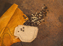 A cup sewn in jute  full of coffee beans. Royalty Free Stock Images