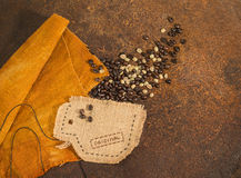A cup sewn in jute  full of coffee beans. Stock Photo