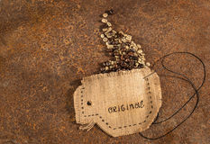A cup sewn in jute with needle and wire full of  coffee beans . Royalty Free Stock Images