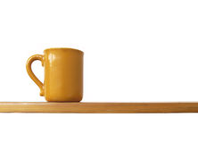 Cup on shelf Royalty Free Stock Photography