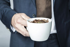 Cup of small coins. Business man Stock Photography