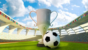 Cup and Soccer ball in the stadium Royalty Free Stock Images